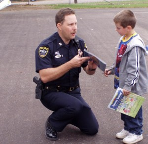 cop talking to kid